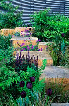 great! Love the wood blocks in between a flower bed serving as steps and as kind of wooden sculptors.
