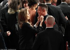 Even A-listers have wardrobe malfunctions: Angelina adjusted Brad's bow-tie in a touching display of affection away from the eyes of the pho...