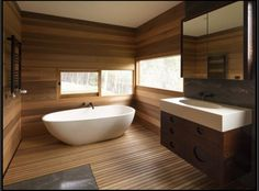 Extraordinary Bathroom Interior Design With Natural Wooden Wall Different And Flooring As Well Bathtub Set On Beside Corner Colorful Small Window Along With Wooden Vanity Single Sink Plus Mirror