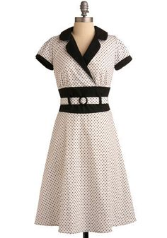 Call Me Dottie dress, ModCloth, $109.99. I love the matching fabric belt that wraps around the contrasting waistband - very cute touch!