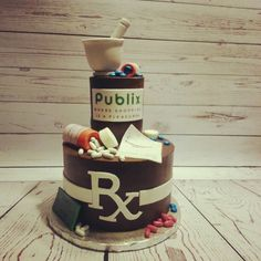 Publix pharmacy graduation cake with sugar mortar and pestle. Chocolate cake filled with triple chocolate brownie and coconut pecan frosting #sweetcreationsbycandi