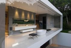 It would be amazing to live in a place where I could have a glass-fronted bathroom like this.
