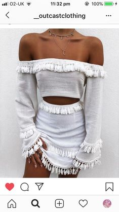 baa29cec3dc White two piece set with fringe / tassels. A spring or summer outfit. The  top is a long sleeve crop top paired with a white mini skirt.