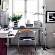 Toio Floor Lamp | Designed by Achille Castiglioni | Produced by Flos