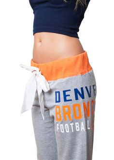 Unwind, relax and enjoy the game in the utmost comfort this Sunday with these oh-so cute Denver Broncos bow sweatpants. Denver Broncos Gear, Denver Broncos Womens, Football Fever, Denver Broncos Football, Go Broncos, Raiders Football, Broncos Fans, School Spirit Wear, Sport Fashion