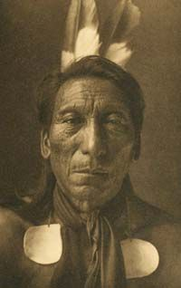 Crow Ghost - born in 1843 in N Dakota. At the age of 17 he accompanied a war-party & himself killed Sioux. This gave him the right to assume his father's name Crow Ghost & in the following year, he took a wife. In the Sun Dance he fasted 4 days & 4 nights & on the last night an old man appeared to him in a vision & said that in order to gain his desires he must sacrifice his flesh to the sun. Awaking, Crow Ghost had one of the men cut a piece of flesh from his shoulder & offered it to the…