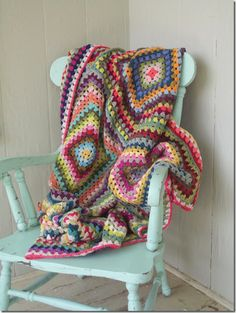 Twelve Block Granny Square Blanket by http://cozymadethings.blogspot.co.uk