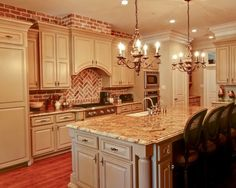 love the cabinets and countertops but not the brick...maybe a dark backsplash