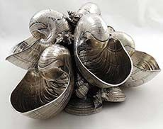 """M Buccellati sterling silver multiple conch centerpiece measuring 6"""" tall and with a width of 11 1/2"""". Weight 85 troy ounces. The body of the centerpiece is made up of nautilus shells joined together and mixed with smaller conch shells and a variety of other small shells."""