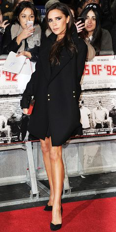 At the world premiere of The Class of 92, Beckham strutted her stuff in a one of her own designs: A fit-and-flared LBD under a black wool coat with a gold box clutch. Black Casadei pumps completed her look.