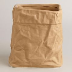 Made of ceramic with the crinkled contours of a folded paper bag, our exclusive storage crock is a quirky addition to the counter that stores all your kitchen utensils in one convenient place. >> #WorldMarket Kitchen Tools and Storage, Kitchen Decor, Tips