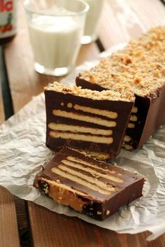 Nutella trunk with 4 materials- Κορμός με Nutella με 4 υλικά Nutella trunk with 4 materials - Greek Sweets, Greek Desserts, Mini Desserts, Delicious Desserts, Yummy Food, Nutella Recipes, Chocolate Recipes, Nutella Biscuits, Sweet Recipes