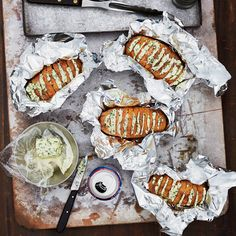 Food & Wine Grill-Baked Potatoes with Chive Butter Recipe. Unsalted butter, fresh chives, sour cream, kosher salt, pepper and baking potatoes. Grilling Recipes, Wine Recipes, Cooking Recipes, Cooking Stuff, Vegan Recipes, Sides For Hamburgers, Burger Sides, Grilled Baked Potatoes, Baked Potato On Grill