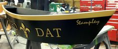 Customized Who Dat pirogue.