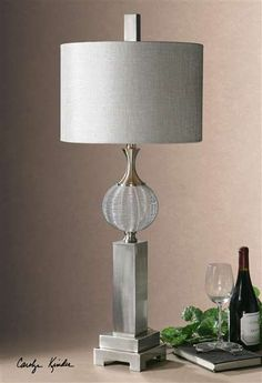 Barzillay Silver Metal Lamp Metal Wire Sphere With Brushed Aluminum Details. The Round, Hardback Drum Shade Is A Silver Taupe Linen Fabric.