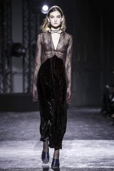 """Played out through coats or sheer blouses and little bras – but it was this dress, this one dress, that really did the talking: a slit down its front and another little reveal for a sli..."