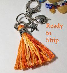 Planner goodies. Orange tassel charm. Planner tassel. Planner decoration. Zipper pull. Starfish charm. Book Club. Purse charm. Shell charm by LaBellaBottega13 on Etsy