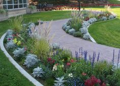 Beautiful landscaping walkway idea,Stamped Concrete and Specialty Gardens