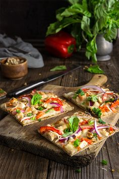 Thai chicken pizza - loaded with crunchy toppings, fresh herbs, and bursting with vibrant Thai flavors.