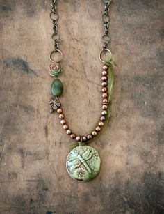 **This necklace is reserved for Jamie-Lynn - thank you!**    This one of a kind necklace features a beautiful ceramic pendant handmade by Nan Emmett of