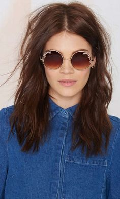 """Get your """"70s vibes on in these gold circle shades with floral detailing, tinted brown shades, and an easy slip-on style."""