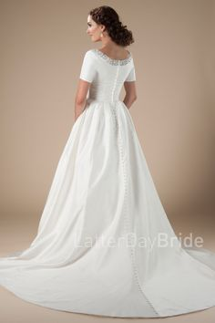 We love the sweet lines of this modest wedding dress! With the soft taffeta skirt and pleated skirt combined with … Pinina Tornai Wedding Dresses, Soft Wedding Dresses, Flattering Wedding Dress, Making A Wedding Dress, Western Wedding Dresses, Luxury Wedding Dress, Perfect Wedding Dress, Wedding Gowns, Wedding Attire
