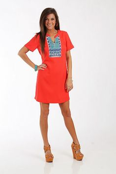 """The Nahla Dress, Coral $46.00 Embroidery alert! The bold colors of this dress are the perfect compliment to the simple, straight silhouette and modest v neck. But the embroidery at the neckline is what really sold us... so beautiful!   Fits true to size. Miranda is wearing a small.   From shoulder to hem:  Small - 33""""  Medium - 33.5""""  Large - 34"""""""