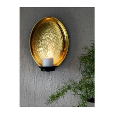 ANGENÄM Wall sconce for block candle IKEA The shiny metal reflects and enhances the warm light from the candle flame.