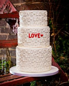 Take typography to another level in your wedding reception! How great is this font focused wedding cake? We love how the simple colors allow the overall meaning to pop.