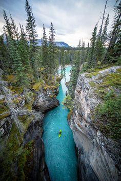 Kayaking Athabasca falls - photo by CHRIS BURKARD 2014 TRAVEL ALBERTA TOURISM SUMMER / FALL SHOOT CANADA CHRISTIAN FERNANDEZ, JEFFREY SPACKMAN