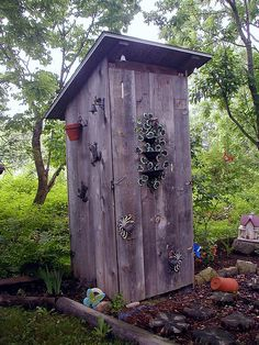Love this outhouse.