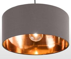 The Hue Pendant Shade in Grey and Copper, super sleek with a warm glow.