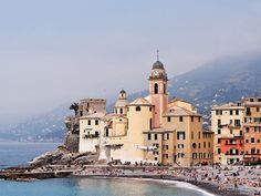 Camogli The small Italian fishing village nestled on the Italian Riviera isn't just pretty—it's surprisingly happening, too. In addition to rows of candy-colored homes, there's a small harbor with shops and restaurants, a carousel near the water, and a big square where children can play and adults can sip coffee and people-watch.