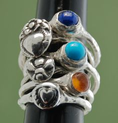 """Fine Silver Menagerie stacking rings and plain stone rings in amber, sleeping beauty turquoise and lapis.$42 ea. for rings without stones, and $50 for rings with stones.  For more info, go to www.rublane.com/shop/marciasouthwick and search for """"menagerie."""""""