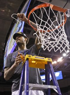 String music. Kentucky's Willie Cauley-Stein holds up a piece of net after Wildcats earned another Final Four. #bbn
