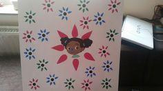 Aanwezigheidsbord voor in de kleuterklas. Kls hangen hun symbooltje in een bloem.