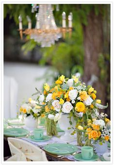yellow and white whimsical centerpieces.