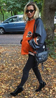 Bright display! Adding a splash of colour the mother-of-one wore an oversized orange bomber with leather sleeves, emblazoned with the Princeton logo