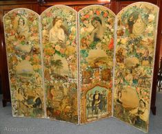 Victorian four fold scrap screen~Each of the arched panels wonderfully decorated and colorful with decoupage scene and edged in velvet with decorative brass studs~The reverse side is covered in Oriental type scenes