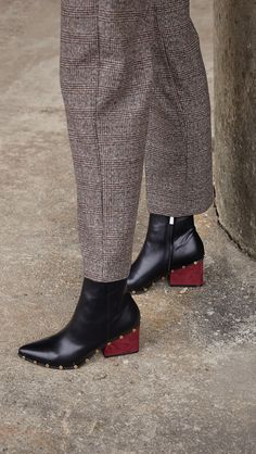 The Ivana Ankle Boots with burgundy colour blocked heel, studded detailing and has a size zipper closing.