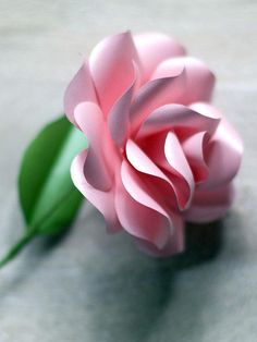 How To Make Paper Roses: Finish wrapping stem with floral tape. Bend and adjust wire to display rose. From DIYnetwork.com
