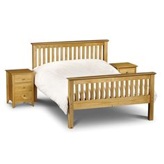 Traditional wooden bed accompanied with night stands.