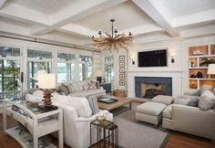 Family room with shiplap walls, shiplap fireplace, coffered ceiling and many wi. Family room with shiplap walls, shiplap fireplace, coffered ceiling and many windows to let the vi Coastal Living Rooms, New Living Room, Living Room Decor, Dining Room, Small Living, Kitchen Dining, Kitchen Cabinets, Living Room Sectional, Living Room With Fireplace