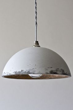 Looking for some durable lighting? Here's some great light fixtures made from cement. Learn how to make your own concrete lamp via homemade-modern.com.