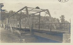 """Darden Bridge over St. Joe River-Only known Truss Bridge in St. Joseph County. Built  in  1885  to  span  the  St.  Joseph  River  at  LaSalle  St,  it  was  initially  known  as  the  """"Four  Mile  Bridge"""". It  was  floated  down-river  in  1906  to  Darden  Road,  having  been  judged  unsuitable  for  the  downtown  traffic  on  LaSalle. It  was  closed  to  cars  in  1970  &  then  closed  to  pedestrians  and  cyclists  in  1985."""