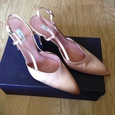 Prada Pink Silk heels size 39 1/2 - best fits 8.5 Prada Pink Silk heels size 39 1/2  Italian so best fits 8.5 worn only once  excellent like new condition. Comes with original box and dust bag  I collect Prada shoes and these were a little too small for me. They best fit an 8-8 1/2 or a narrow 9  Pink is so in right now and always classic. great Spring/Summer date shoes and fabulous for weddings and parties. Prada Shoes Heels