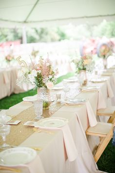 Pink wedding reception decor idea - ivory table linens, gold sparkly table runner and blush + greenery centerpieces {Courtesy of Angie Wilson Photography}