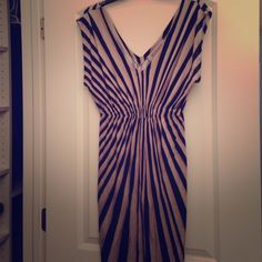 Navy blue and tan striped dress from Remain This navy blue and tan striped dress is extremely figure flattering and the stripe pattern creates an optical illusion to make your bod look the best that it can! As seen on Hanna from PLL! Purchased from Nordstrom. Excellent condition. remain Dresses