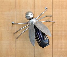 "Zappa is a bug zapper by artist Kevin Caron that you'll want to put in your backyard! Stainless steel, steel and bug zapper. 7"" x 18"" x 17"" $1200"
