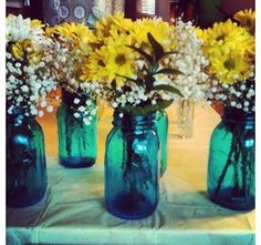 blue mason jars with flowers. very country and cute. used for a baby shower.